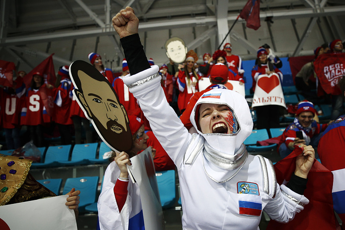 A fan of the Olympic athletes from Russia cheers before the men's gold medal hockey game against Germany at the 2018 Winter Olympics in Gangneung, South Korea, February 25