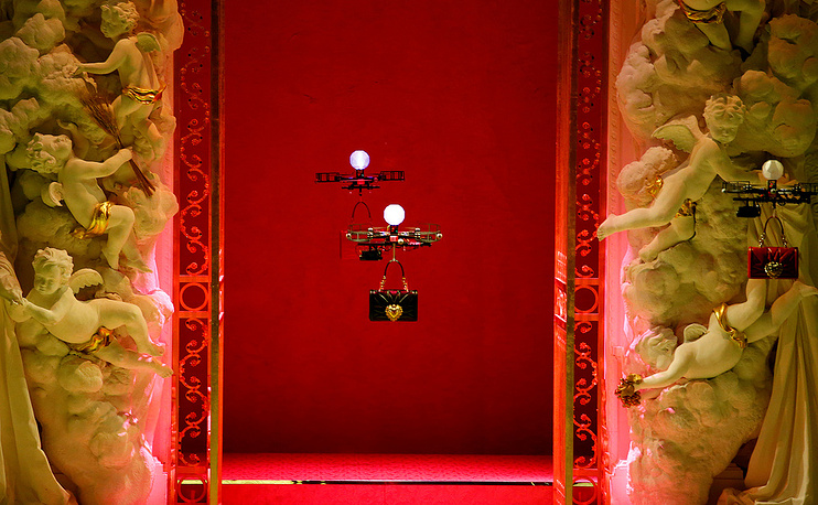 Drones carrying bags from the Dolce & Gabbana Autumn/Winter 2018 women's collection during Milan Fashion Week in Milan, Italy, February 25