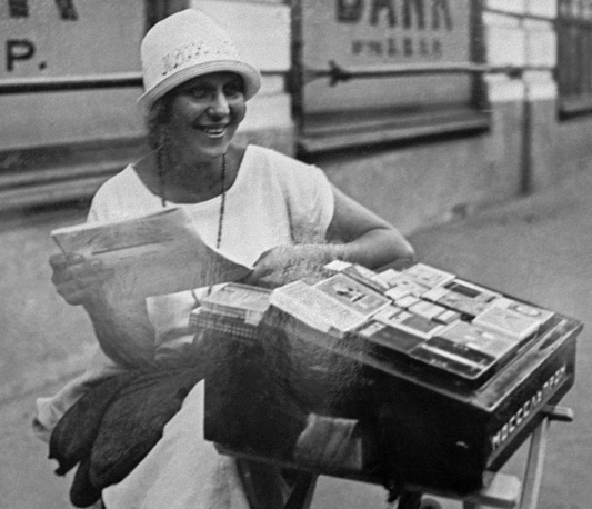 A woman selling cigarettes in a street, 1925