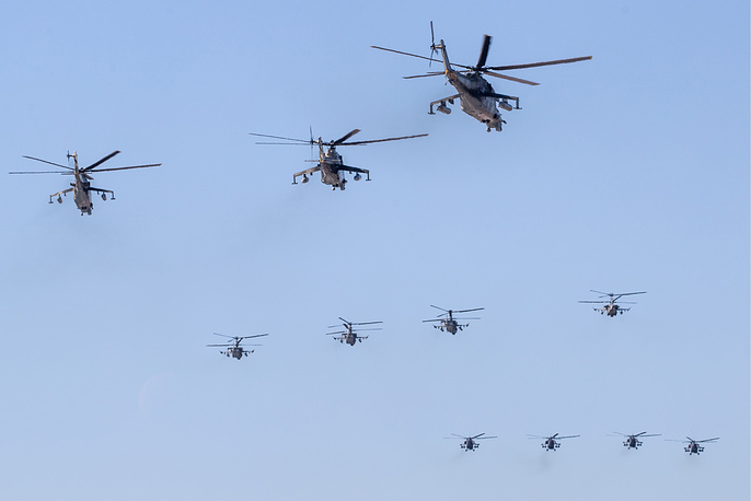 Mil Mi-24, Kamov Ka-52, and Mil Mi-28N combat helicopters rehearse an air show at the Kubinka air base