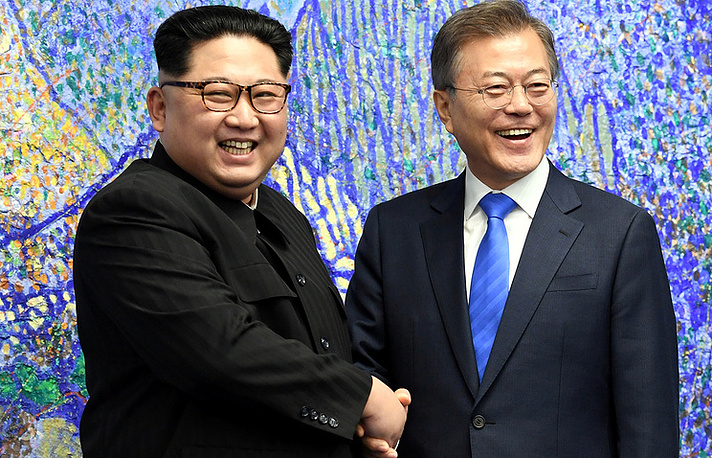 North Korean leader Kim Jong Un poses with South Korean President Moon Jae-in for a photo inside the Peace House at the border village of Panmunjom in Demilitarized Zone
