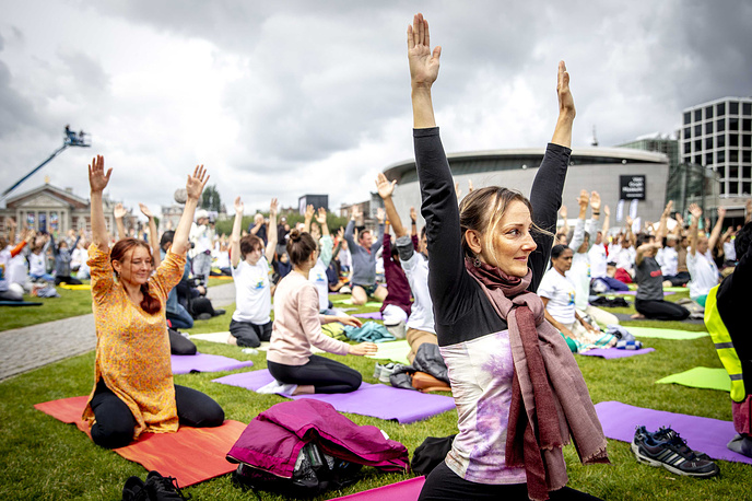 Participants take part in a mass yoga event, to celebrate the International Yoga Day, in Amsterdam, The Netherlands