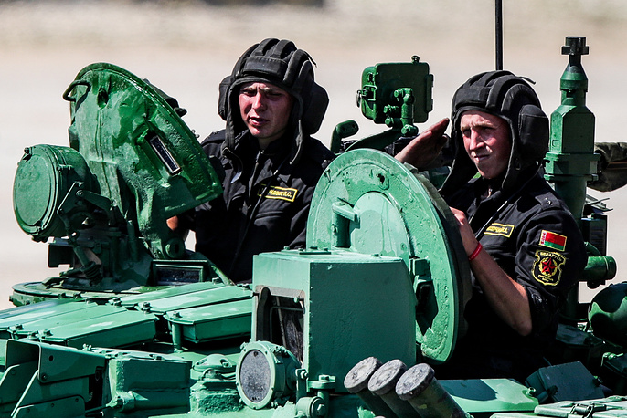 Members of the Belarusian team on a T-72B3 tank