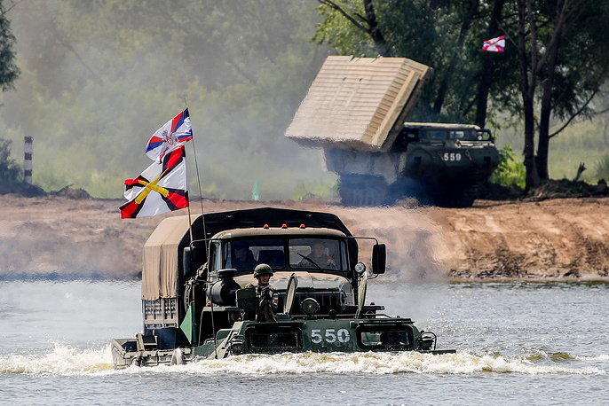 Russian military truck on a PTS-2 amphibious cargo vehicle