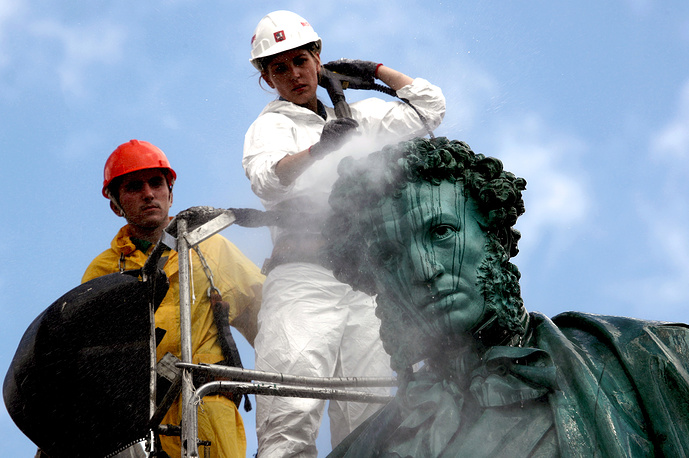 Washing a statue of Russian poet Alexander Pushkin, Moscow, August 9
