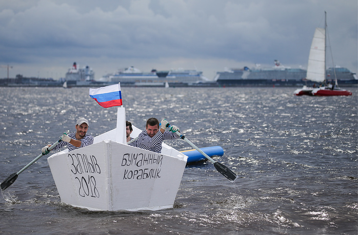 People paddling a boat made of foam plastics at the 2018 Zaplyv festival of handmade inflatables, St Petersburg Park, August 5