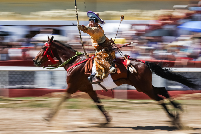 A Yabusame performance at the Central Moscow Hippodrome, August 11. Yabusame is a type of traditional Japanese archery, when an archer on a running horse shoots three arrows at three wooden targets
