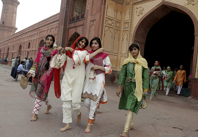 Muslims around the world celebrate Eid al-Adha, or the Feast of the Sacrifice. Photo: Pakistanis in festive dress leave a mosque after offering the Eid al-Adha prayers, in Lahore