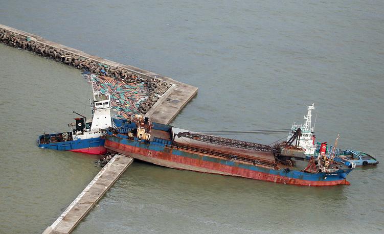 A ship stranded on a seawall in Nishinomiya, western Japan