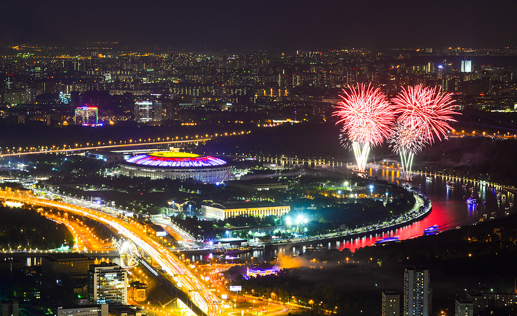 Fireworks bursting in the night sky over Moscow's Luzhniki Stadium