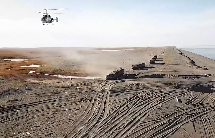 DT-30PM tracked carriers and a helicopter on the coast of the Chukotka autonomous area