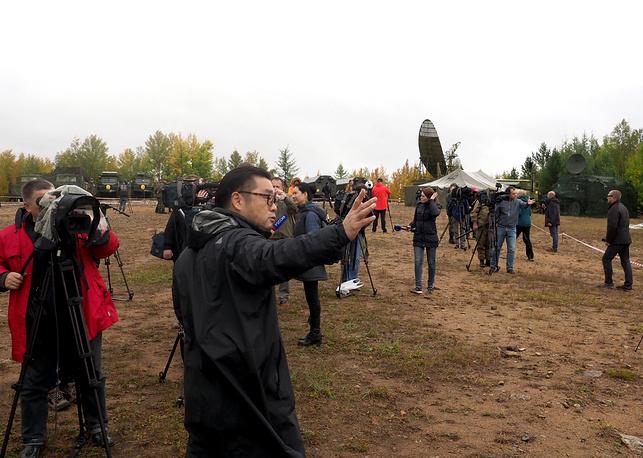 Journalists taking pictures at Telemba training range