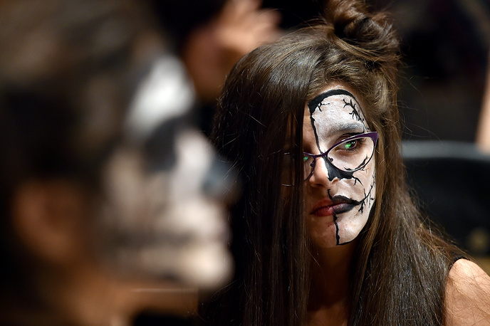 A young woman has her face painted as she attends a Halloween Party in Hazmieh area, Beirut, Lebanon
