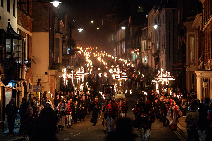 Bonfire parade through the streets during the traditional Guy Fawkes Night celebrations in Lewes, England, November 5. The night's events commemorate Guy Fawkes, who planned the failed 1605 Gunpowder Plot - an attempt to blow up The Houses of Parliament by a group of English Catholics