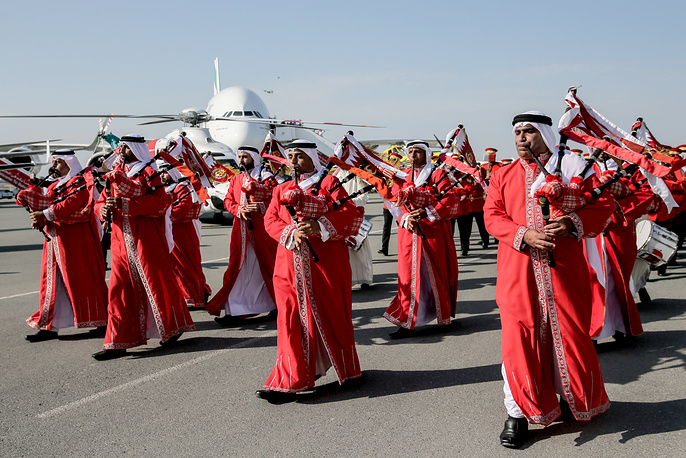 Orchestra musicians in traditional costumes perform at the 2018 Bahrain International Air Show