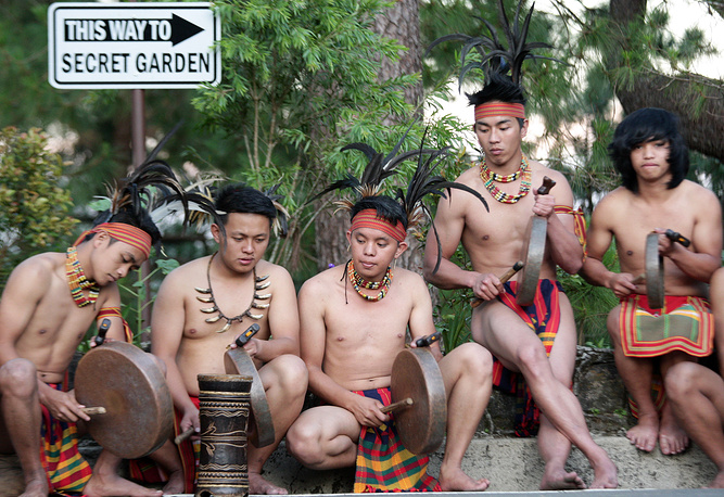 Members of the Filipino indigenous tribe 'Igorot' clad in traditional costumes perform with their gongs during a media tour in Baguio city, Philippines,  November 12
