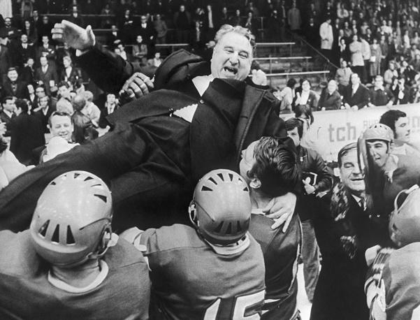 Soviet ice hockey national team and coach Anatoly Tarasov are seen after winning IIHF World Championship, Switzerland, 1971
