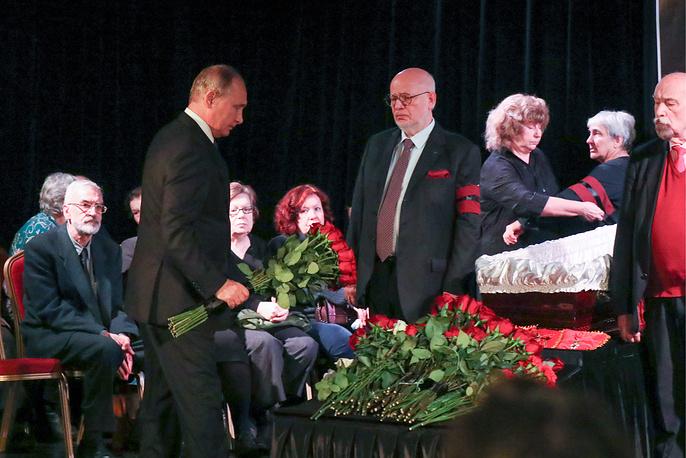 Russia's President Vladimir Putin lays flowers as he pays last respects to Lyudmila Alekseyeva