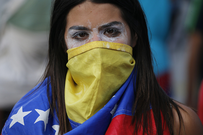 An anti-government protester is seen in Caracas