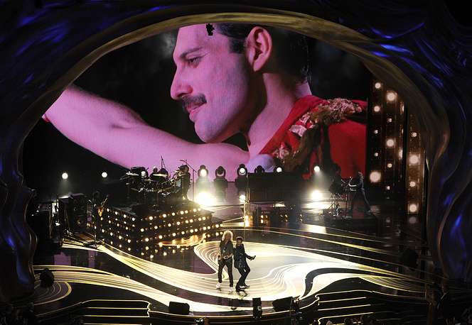 An image of Freddie Mercury appears on screen as Brian May and Adam Lambert of Queen perform at the Oscars on at the Dolby Theatre in Los Angeles