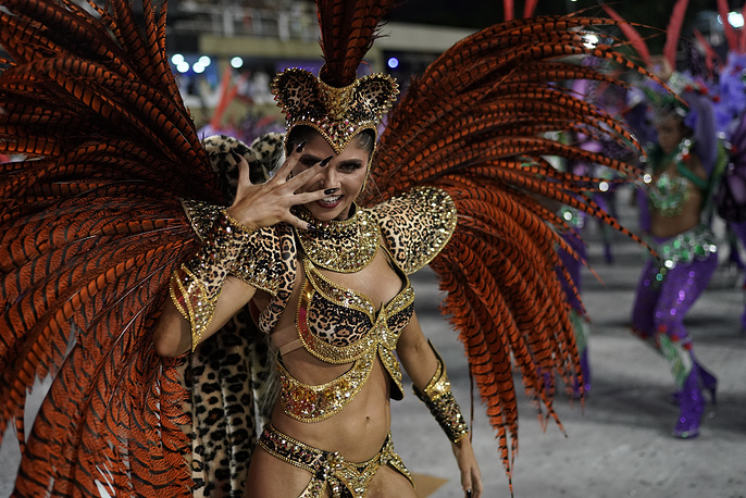 A performer from the Academicos do Grande Rio samba school parades during Carnival celebrations at the Sambadrome in Rio de Janeiro