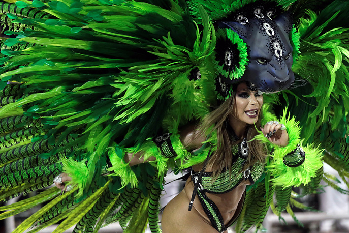 Dancer from the Mocidade Alegre samba school performs during Carnival celebrations at the Anhembi Sambadrome in Sao Paulo