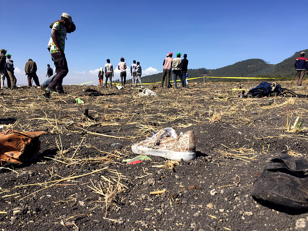 People walk at the scene of the Ethiopian Airlines Flight ET 302 plane crash, near the town of Bishoftu, southeast of Addis Ababa, Ethiopia, March 10