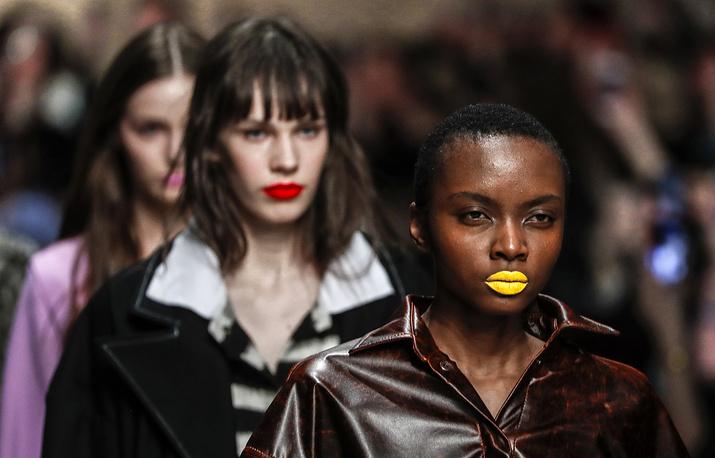 Models present creations by Russian designer Alexandr Rogov