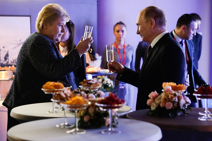 "Norway's Prime Minister Erna Solberg and Russia's President Vladimir Putin having business lunch as part of the 2019 International Arctic Forum titled ""Arctic - Territory of Dialogue"" at the ExpoForum Convention and Exhibition Centre, Saint Petersburg, April 9"