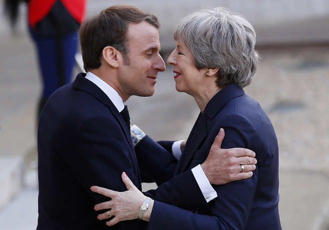 French President Emmanuel Macron greeting British Prime Minister Theresa May before a meeting at the Elysee Palace in Paris, April 9