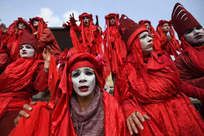 The Blood of the Extinction theatrical group performing during Extinction Rebellion climate change protests on Waterloo Bridge, during climate change protests in London, April 17