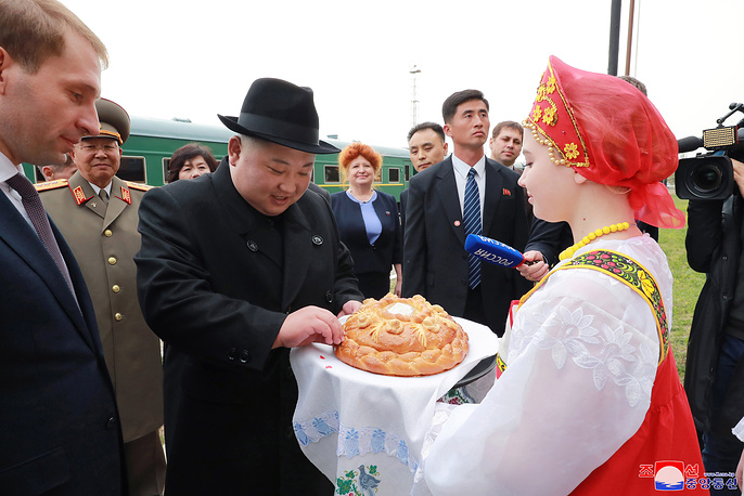 North Korean leader Kim Jong-Un receives a traditional bread during a welcome ceremony in Vladivostok, April 24