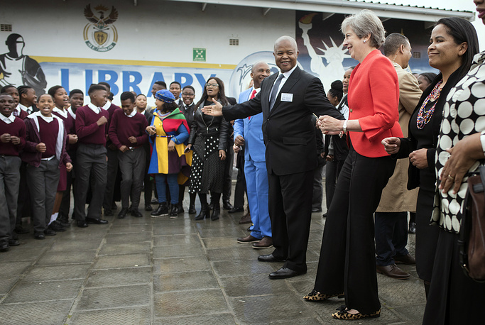 British Prime Minister Theresa May dancing with pupils at the ID Mkize secondary school in Cape Town, South Africa, 2018