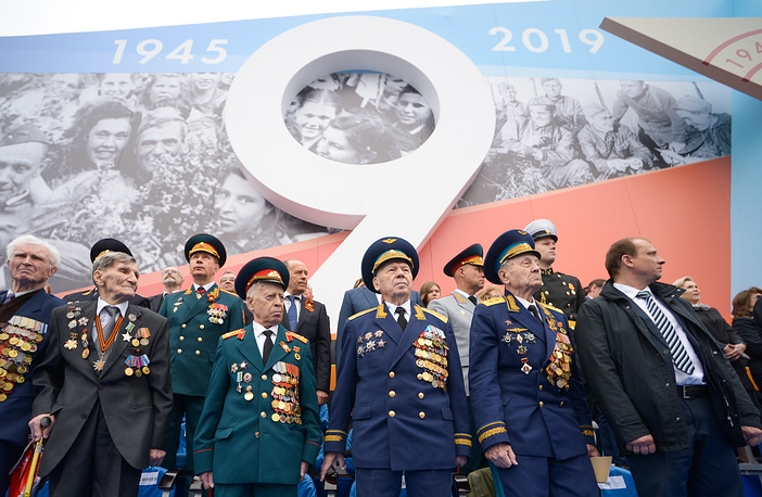 Veterans watching a Victory Day military parade in Moscow's Red Square.