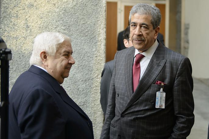 Министр иностранных дел Сирии Валид Муаллем (слева) и помощник спецпредставителя ООН и ЛАГ Мохтар Ламани
