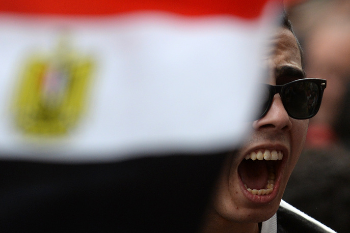 Участник протестов в Каире