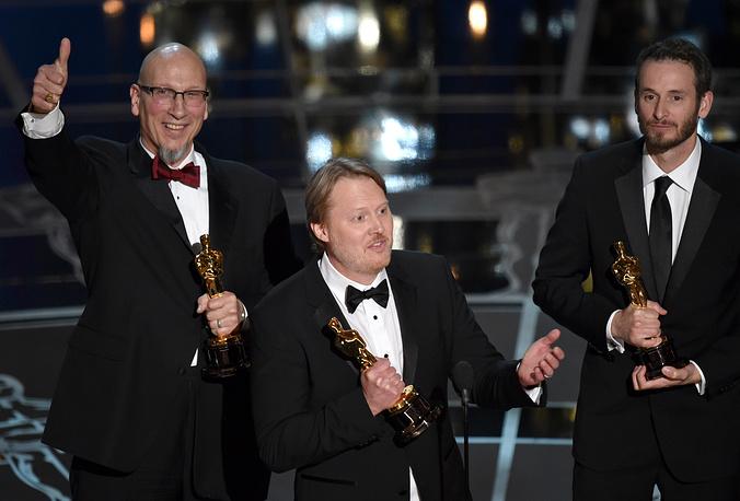 """Лучшим анимационным фильмом стала лента """"Город героев"""". На фото: Рой Конли, Дон Холл и Крис Уильямс (слева направо)"""