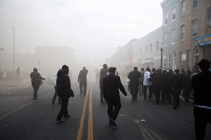 В ходе волнений были арестованы 27 человек. На фото: акция протеста против действий полиции в Балтиморе