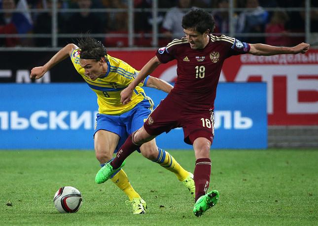 Олбин Экдаль и Юрий Жирков в борьбе за мяч