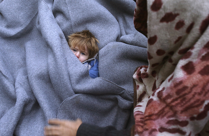 Ребенок в лагере мигрантов на сербско-хорватской границе, 20 октября
