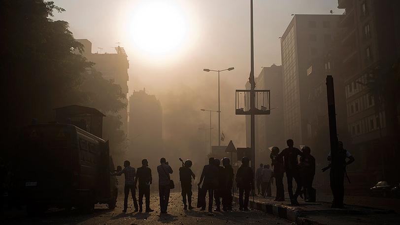 Столкновения во время митинга в Каире. Фото AP Photo/Hassan Ammar