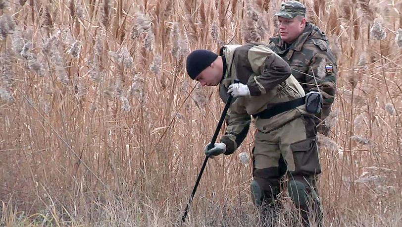 Эксперты на месте теракта. Фото AP /AP Video