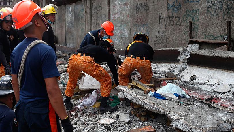 Спасательные работы на Филиппинах после землетрясения. Фото AP Photo/Chester Baldicantos