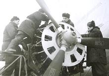 Иван Анопченко с коллегами обслуживает самолет, 1950-е годы