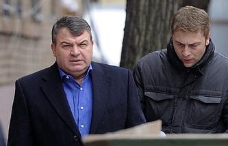 Former defense minister Anatoly Serdyukov (L)
