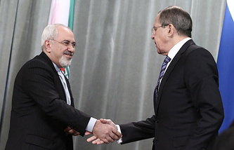 Russia's foreign minister Sergei Lavrov (R) and his Iranian counterpart Mohammad Javad Zarif
