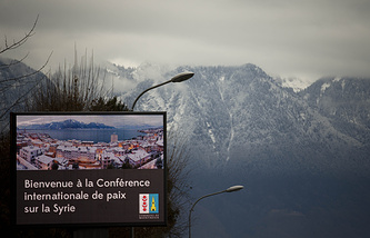 A giant screen at the entrance of the Swiss resort of Montreux welcomes to this week's Syria peace talks in Montreux and Geneva, Switzerland