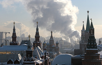 Steam from an electric power plant rises over Red Square with historical museum, left, St. Basil's cathedral, central, and Kremlin, right, in downtown Moscow