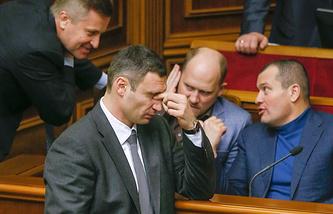 Ukrainian opposition leader Vitaliy Klitschko reacts during parliament's session in Kiev