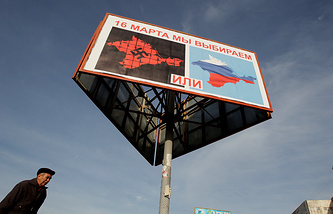 A poster calling people to vote in the upcoming referendum in the Crimea